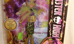 BRAND NEW in sealed box, never displayed or removed. Great gift for collectors. From the Freaky Fusion collection, Clawvenus doll. Accessories include a to-die-for purse, doll stand, brush and humorous fusion diary! In a freaky twist of adventure, some of