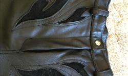 Unique custom made lined ladies leather motorcycle pants. Approximately Size Medium. Front and back pockets, full zippered, snap legs with cuff extensions. Rarely used, new condition.