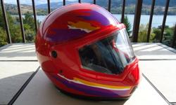 Very good condition motorcycle or snowmobile helmet made by Snell, double lens shield anti fog front air vents, size medium to large, wont be disapoited, great price, firm please, call 778-930-0193