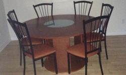 Round table, set of 6. Barely used. Perfect condition. 6 chairs and with round table with center glass piece $500 White futon bed for sale, Real wood and barely used Can be converted into a full size bed, comes with the mattress. $ 800 Can be sold