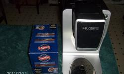 FOR SALE A USED IN EXCELLENT CONDITION MR.COFFEE KEURIG SINGLE CUP COFFEE BREWER WITH A TIMOTHYS 18 PACK COFFEE