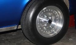 """Set of 15"""" Rims (Western-Trans Am style) Set of Tires (Uniroyal-Tiger Paws) with lots of tread left. Offset size: fronts are 205/70/15 and rears are 225/70/15 *** Near perfect condition wheels *** $600 O.B.O. or TRADE Currently on my '69 Firebird, but"""