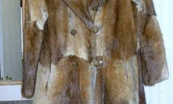 have a 3/4 length muskrat fur coat which is a size medium   Made by Kindy's