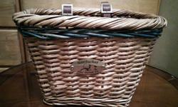 Wicker basket with leather and brass straps. BANK/GLEN AVE. area