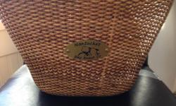 """This lovely wicker basket was purchased on line and then never used. From the Nantucket Basket Co. Has leather straps. Measures 14x9.5"""" and 8"""" wide. In perfect condition."""