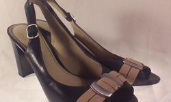 Size 8 1/2 M, worn once, box included Navy and beige, 3.25 - 3.5 inch heel