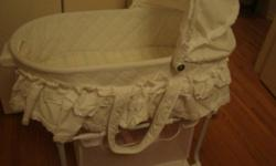 Beautiful bassinet for sale,only use 2 month$50.00 Evenflo carseat good condition $15.00 baby feeding chair$10.00
