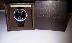 Selling my Black Chronograph watch with Swarovski Crystals. Ladies' Watch with 2 links taken out to fit a smaller writst. I received it for a birthday present and have actually never worn it. Still in the box with the links in the box in case you'd need