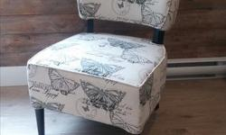 """Neutral background with colored butterfly pattern in blues and green. Perfect unused and new condition. Very comfy and lightweight chair that would look good in a living room, bedroom or hallway. 23"""" wide x 25"""" deep x 31"""" tall"""