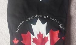 """Attractive Canada themed t-shirt """"united peoples of canada"""" Black with maple leaf in center 100 % cotton New, with tag still attached Could be worn by male or female Size: L $10 each Two are available"""
