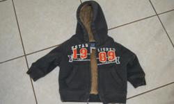 6-9 Months. The Children's Place faux fur lining baby boy hooded sweatshirt (very warm). $10. Pick up Woodroffe and Baseline. Non smoking and pet free home.