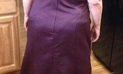 Size 18. A- line. Plum colour. One shoulder with beautiful crystal embellishment. Floor length. Roushing on the side for flattering tummy. Satin material provides structured look. Tags still on / never altered or worn other than to try on. Priced for