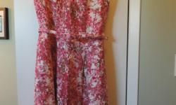 Very elegant dress for the special occasion this summer. Cotton, fully lined. Tag was removed, but never worn. This is a fitted look with a belt made of the same material.