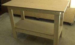 Brand New Very solid, and stable workbench or work table $70.00 assembled (as shown in photos 1 and 2) 24 inches deep X 48 inches wide X 33 inches high 2x4 construction, Screwed from the inside nice and clean look (no visible screws) brand new MDF top