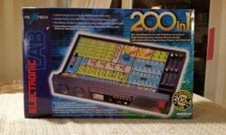 Nextech 200 in 1 Electronic Project Lab...allows you to build 200 electronic projects...transmiiter radio, weather radio, fm radio, to name a few. Used once, and stored for 5 years. $25.00 OBO