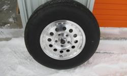 4 aluminium outlaws, 5 stud wheels(7.5 by 15),mounted on 4  235r75/15 all season radials,only used 4 months,they never seen any salt or winter conditions,they come complete with all stainless steel spline nuts & locks,like new condition,they were mounted