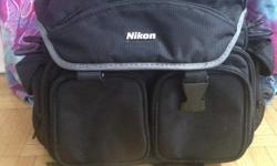 Nikon Professional Camera bag with shoulder strap. Several pockets for just about anything you will need for your photography excursions. Very good condition.