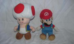 """Hello, we are selling a set of two plush Nintendo Mario toys, Mario and Toad. They are both about 8"""" tall. They are in very good condition with some minor wear. Price is $20. We are in Orleans near Charlemagne and Valin; please contact us for pickup in"""