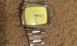 lime green nixon watch with a little diamond got a few scratches on the face but still in good condition fits a small wrist
