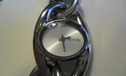 """NIXON women's watch """"Off the Chain"""" style - THE ALICE. Never used. Great condition. Needs new battery. 30M Stainless steel 9 Inches from end to end Normally $200.00 + Will ship (within Muskoka)."""