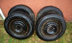4 - P215/70R15 ON RIMS, IN EXCELLENT CONDITION. Balanced, ready to install. Only three months on the road last winter. They do not fit my new car. Would be over $750.00 new, at best! Off a 2002 Chevy Venture Van. Beleived to be 5x115mm  lug patern. 15x6