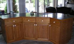 Beautiful solid oak kitchen custom made cabinets In good condition. Must be seen to be appreciated. Appliances not included. However, black hood fan can be included Remodeling kitchen