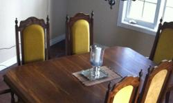 "Oak table with 2 leaves, 2 captain chairs & 4 regular chairs. Size: 67"" without leaves x 42"" wide 82"" with one leaf 98"" with both leaves Please call Liz at 519-865-3763 This ad was posted with the Kijiji Classifieds app."