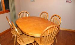 Oak Dining Table with 6 chairs - $300 OBO.  Oval dining table has one leaf - photos show the table with the leaf in.  From a smoke-free home. Please contact if interested.
