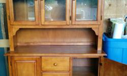 Solid wood hutch. Perfect for a kitchen or dining room. In excellent condition with 3 drawers and plenty of storage space. Dimensions 6.4ft H, 4.3 ft W, 1.6ft D $200 or best offer