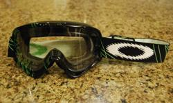 Oakley O Frame motocross Goggles. Used, but in brand new conditon.   $40, cash only.   Integrated Custom Painted Frame and Strap Graphic NoFog? Anti-Fog Lens Treatment NoSweat 3.2 Face Foam Durable Silicone-Lined Strap ProAir Nose Guard RAM Air