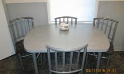 Grey table top - 4 - Chairs are black and grey nice set. Phone calls only 306 525-6077 No Emails $250.00 OBO