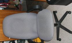 two black Faux leather chairs $15.00 each, one leather swivel office chair $50.00, one grey cloth swivel chair $35.00
