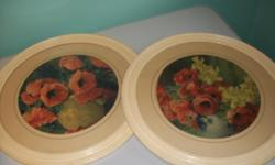 A variety of old framed prints and pictures.