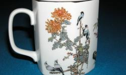 Hexagon shaped mug in excellent condition. Gold trim around top and along handle. Made in Japan mark on bottom with another symbol. Has 3 images of birds and plants and some Japanese lettering down one side. Not sure how old it is but mother has had it