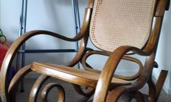 Rocking chair with wicker backing. In great condition, considering its age.