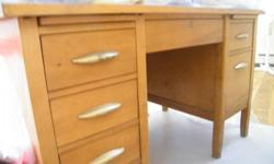 Desk is at least 30 years old and is still in good condition.  I believe it is oak. All original hardware - a great refinishing project! Make a reasonable offer!
