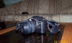 Professional style camera in high quality, been taken good care of, comes with battery charger, camera cord, and lens extension to block out sunlight -manual zoom, 10 mega pixel, ten deifferent photo option settings, view this site for a review and