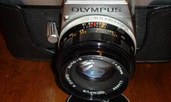 Olympus FTL SLR 35mm film manual camera Olympus f.zuiko auto-s 1:1.8 f=50 lens original leather case Mint condition Available if you see this ad Serious only please