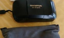 Olympus Stylus film camera in good working order including manuals, strap and case.
