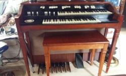 It is a Hammond electric organ, model L-111. Manufactured between 1962-1975. still works and plays well, comes with the bench. Well maintained, just looking to downsize. If anyone is interested, please email me :)
