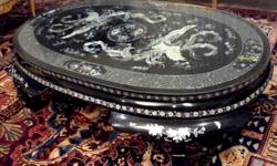 """Oriental coffee table High gloss black laquer finish with real mother pearl inlay. High gloss black lacquer finish. All hand made in Korea. A one of a kind rare piece of art. Size is 53"""" L x 31"""" W X 15"""" H 60 """" X 64 """". All pearl inlay are three dimension"""