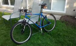 Oryx mountain and road bike for sale. Blue with good tires, small pouch for repair kit under the seat. Clean and works well. Jett rock shock suspension good, newer handles. Chromoly frame. About 8 years old. Good to go! Firm price.