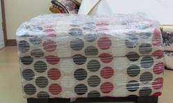 """Brand new ottoman 34"""" X 24""""and 4 throw pillows for sale, never used. Sale price 699$ asking 300$. Cream colour with red, white, black and grey polka dots. Ottoman opens up for storage. Was part of a sofa set that I bought and doesn't match with my decor."""