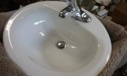 Oval bathroom sink assembly with Moen tap included. Chrome. Very good shape.