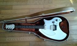 Serious enquiries only....Beautiful electric guitar. This baby is in great shape for 40 year old. Plays great, sounds better with twin humbuckers and built in pre-amp technology. Double octave neck. Original hard travel case. Hate to part with it but I
