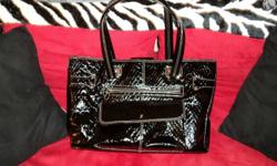 I have a black oversized purse/bag up for sale. It has many compartments (Built in wallet, cell holder, laptop section, etc) I paid $45.00 and I've never used it.   Asking $20.00   Please reply to this ad or send me a text. No phone calls, please. Thank