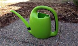 This is a super comfortable-to-hold and high capacity OXO watering can. The spout folds in to make for easier storage. Holds over 2 gallons of water.