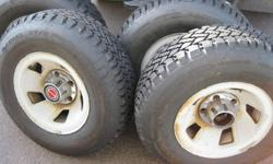 4 - P235/75/R15 Snowtires mounted on Ford Rims.  Will fit F-150 up to 1998 and possibly other makes.   Tires have less than 200 km on them.   Tires alone were over $600.   $500 firm for the set with center caps.   Email only.  Cash ... no trades.