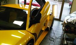 -Specializing in High End and Exotic vehicles  -Lease return repairs -HAIL damage repair approved by all insurance companies -aluminum panel repairs -less $$ than bodyshop repairs -most repairs while you wait -visit our website to see real before and