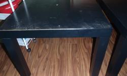 2 black square ikea tables. 10 for the pair. One shows damage on the top where the veneer has worn through. Both have some where on the legs.